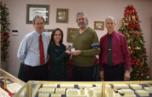 The winning ticket for this year?s United Way of Greater Oswego County diamond ring raffle was drawn on Christmas Eve at DuFore Jewelers in Oswego. Pictured from left are Greg DuFore, United Way Resource Development Director Lexie Wallace, raffle winner Bob Dexter, and Mark DuFore. This year?s raffle raised a record total of more than $3,200 to support the United Way?s Annual Campaign