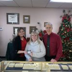 The winning ticket for this year?s United Way of Greater Oswego County diamond ring raffle was drawn on Christmas Eve at DuFore Jewelers in Oswego. Pictured from left are United Way Resource Development Director Stacey Morse, raffle winner Jodi Lawton, and Mark DuFore. This year?s raffle raised a record total of more than $3,300 to support the United Way?s Annual Campaign.